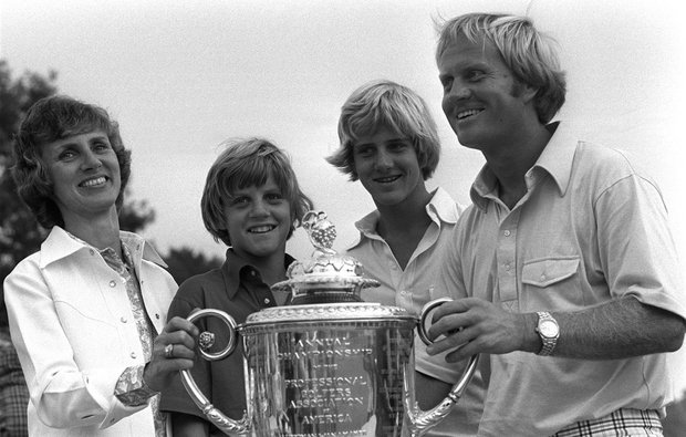After winning the PGA Championship, Jack Nicklaus, his wife, Barbara and sons Steve, left, and Jack Jr. pose with the trophy at the Firestone Country Club in Akron, Ohio, Aug. 10, 1975
