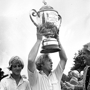 Golfer Jack Nicklaus holds up his PGA championship trophy after winning it for the fourth time at the Firestone Country Club in Akron, Ohio on Aug. 11, 1975.