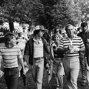 """Golfing great Arnold Palmer walks with members of his """"Army"""" as he walks to the first tee for a practice round on Monday, August 10, 1976 at Congressional Country Club, Bethesda site of the 1976 PGA championship"""