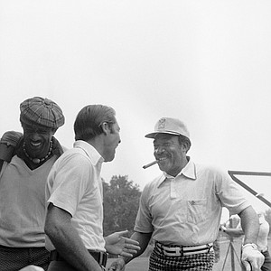 Golfers Gary Player, left, and Charlie Sifford share a light moment prior to a practice round, Aug. 10, 1976 at Congressional Country Club in Bethesda, Md., site of the 1976 PGA championship.