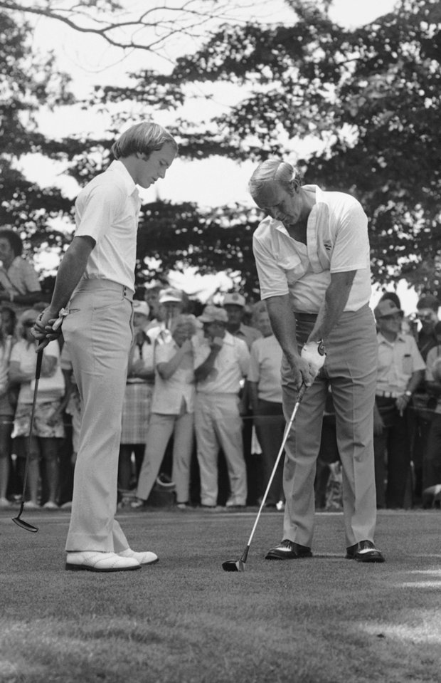 Arnold Palmer gives some friendly advice to U.S. Open champ Jerry Pate, left, as the two met on the practice tee prior to a practice round on Wednesday, August 11, 1976 at Bethesda's Congressional Country Club.