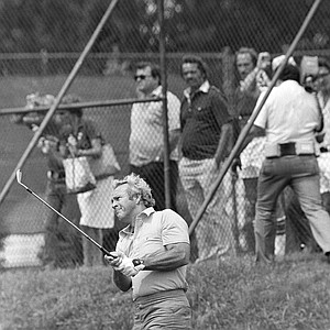 Arnold Palmer, who has never won the PGA Championship, watches the ball during practice on the driving range of Oakland Hills Country Club, site of the 61st PGA Championship, Monday, July 31, 1979, Birmingham, Mich.
