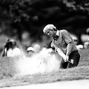 Jack Nicklaus, who led the PGA at the end of the third round, blasts out of the sand on the seventh hole of the Oak Hill Country Club during fourth round of the PGA Championship in Rochester, N.Y., Sunday, Aug. 10, 1980.