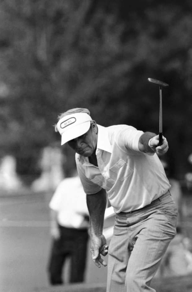 Arnold Palmer keeps a close eye on the ball as he makes a birdie shot on the 7th hole during the opening round of the PGA Championship at the Atlanta Athletic Club, Thursday, Aug. 6, 1981, Duluth, Ga.