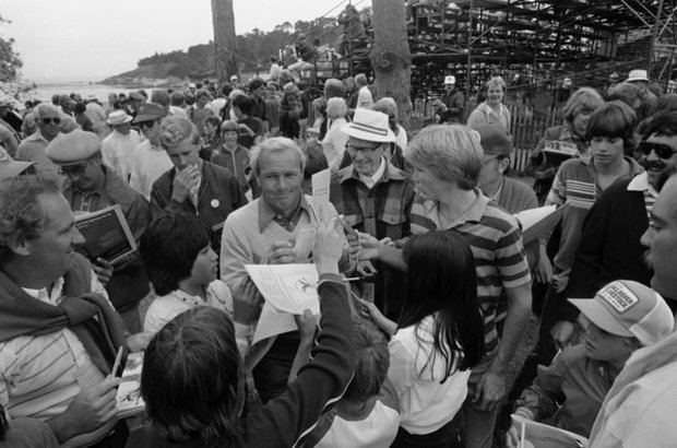 Arnold Palmer obliges his ever present army with autographs following his practice round on Wednesday, June 16, 1982 in Pebble Beach, Calif. as he prepared for the opening round of the U.S. Open on Thursday.