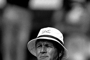 Arnold Palmer one-time king of golf, takes a look down the fairway from the third tee at Southern Hills Country Club, Aug. 4, 1982 in Tulsa, Okla., during a practice round for the PGA Championship. Palmer, who never won the PGA title, sees similar problems for U.S. Open and British Open champion Tom Watson.