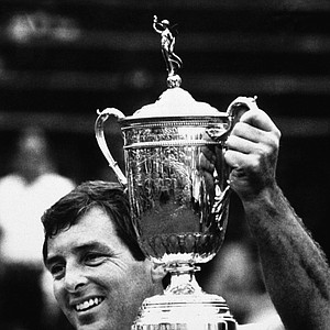 Fuzzy Zoeller holds the winner's trophy after winning the U.S. open championship at Winged Foot Golf Club in Mamaroneck Monday, June 18, 1984. Zoeller defeated Greg Norman in an 18 hole playoff to take the title after the two tied at the end of the regulation 72 holes