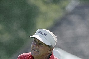 Arnold Palmer watches the flight of a drive during the second round of the PGA Championship, August 9, 1985, Denver, Co.