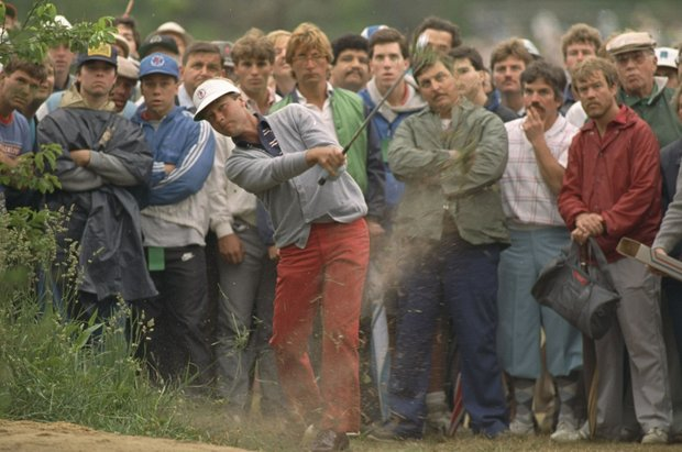 Ben Crenshaw and his gallery watch his shot from the rough on the fairway of the third hole of Thursday's opening round of the U.S. Open Golf Championship at Southampton, N.Y., June 12, 1986. Crenshaw recovered with the good shot from the grass to save par on the hole.
