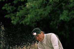 Lee Trevino watches his chip shot from a wet sand trap on the second hole of the second round of the U.S. Open Golf Championship in Southampton, N.Y., June 13, 1986.