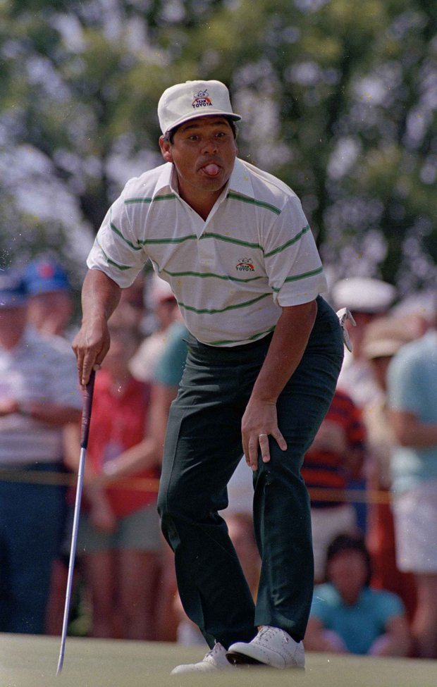 Lee Trevino sticks his tongue out at the ball as he misses a putt for a birdie on the second hole of the third round of the U.S. Open Golf Championship in Southampton, N.Y., June 14, 1986. Trevino saved par on the hole.
