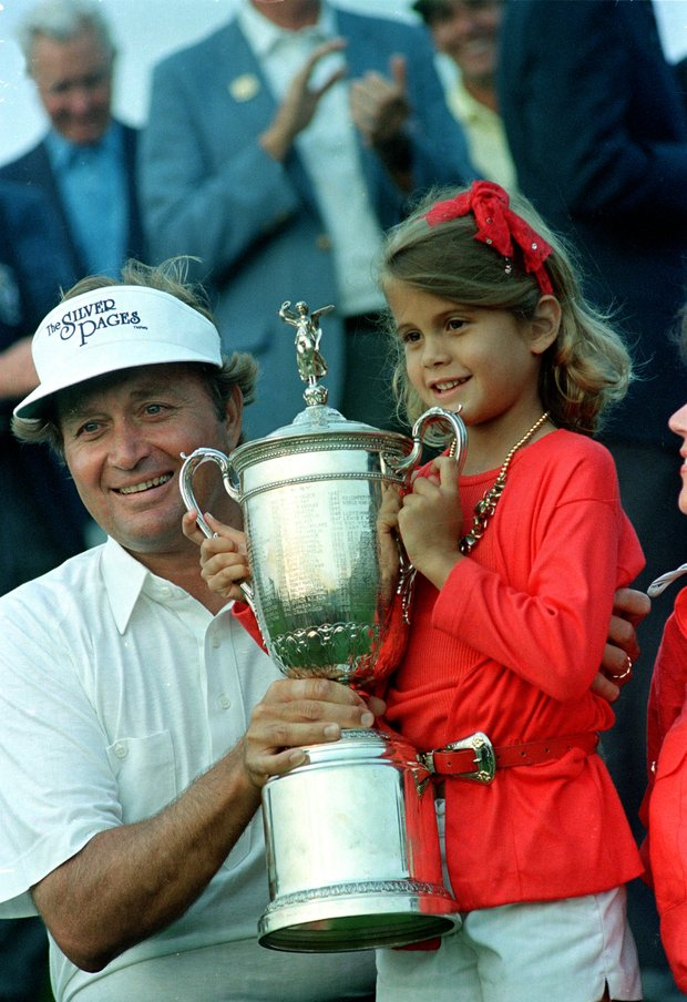 Golfer Ray Floyd holds the U.S. Open Championship trophy cup with his daughter, Christina, after winning the tourney in Southampton, N.Y., Sunday, June 15, 1986.