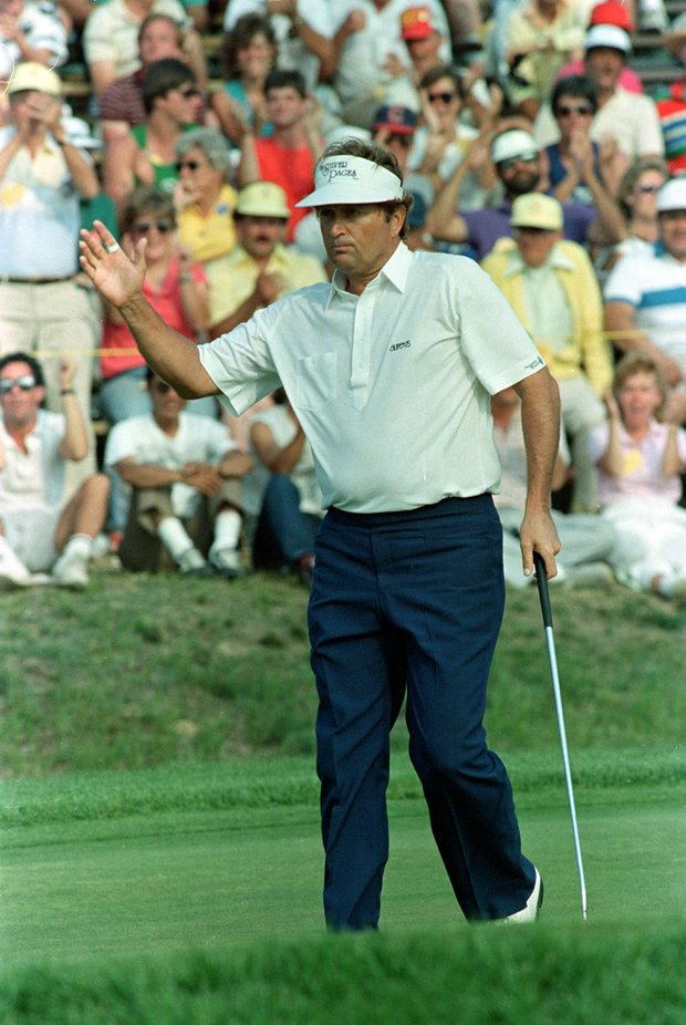 Ray Floyd acknowledges the cheers of the crowd after sinking a birdie putt on the 16th hole of the U.S. Open Golf Championship final round in Southampton, N.Y., Sunday, June 15, 1986. Floyd became the oldest golfer to win the U.S. Open.