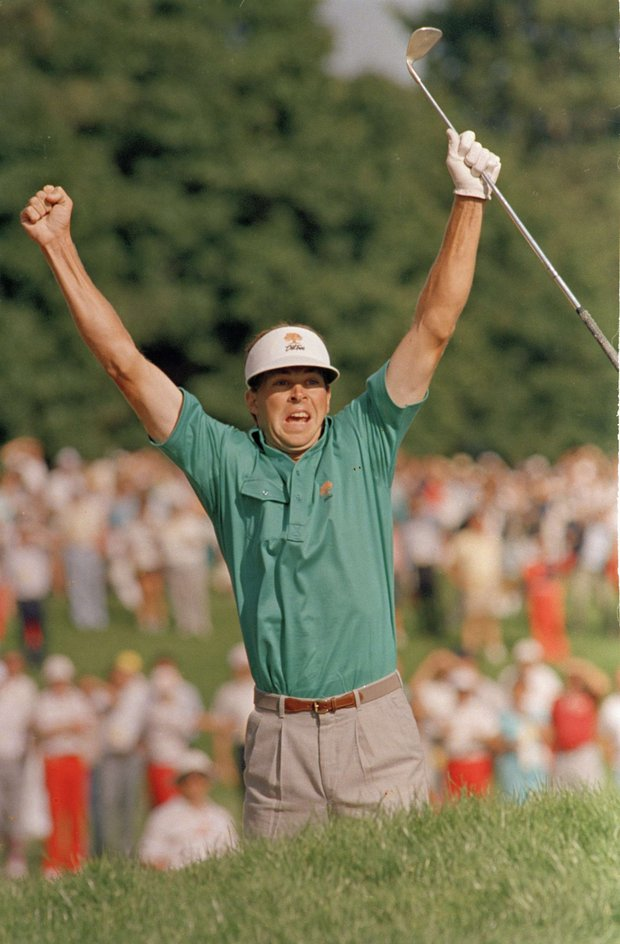Bob Tway leaps into the air after sinking a birdie sand trap shot on the 18th green in the PGA Championship to defeat Greg Norman by one stroke at Toledo, Aug. 11, 1986.