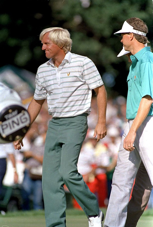Greg Norman walks off the 18th hole after Bob Tway sank a birdie sand trap shot to win the PGA Championship one stroke better than Norman at Toledo, Aug. 11, 1986