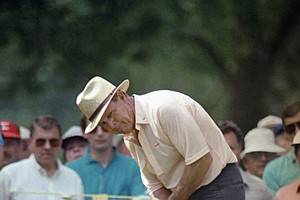 Arnold Palmer keeps a close eye on the ball as he putts on number 3 hole on Thursday, August 6, 1987 in Palm Beach Gardens, during opening round of the PGA Championship at the PGA National Golf Club.