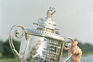Larry Nelson of Marietta, Ga., holds up the PGA Championship trophy in Palm Beach Gardens, Florida, on Sunday, August 9, 1987 after he defeated Lanny Wadkins is playoff action. Nelson took the championship when Wadkins missed a putt for par on the first hole of the playoff.
