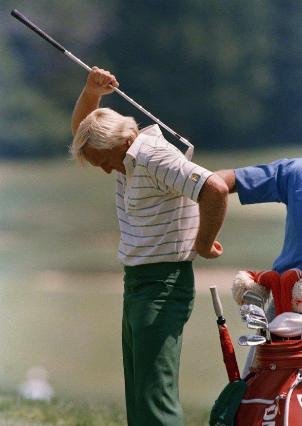 Australian Greg Norman uses his putter to scratch his back during practice on Tuesday, June 14, 1988 in Brookline, Mass. at the Country Club for the upcoming U.S. open official play begins Thursday.