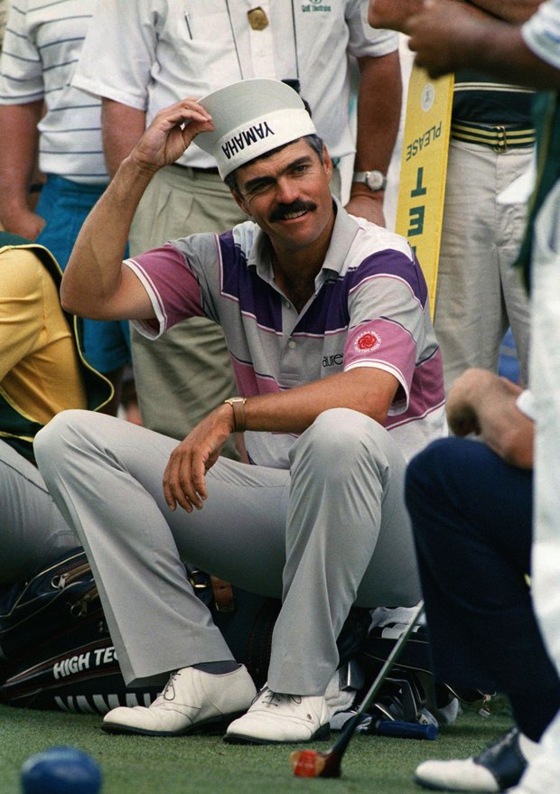 Scott Simpson clowns around during the rain delay on Saturday, June 18, 1988 in Brookline, Mass. at the U.S. Open. Simpson finished the day with a 72, -6 under par for the tournament.
