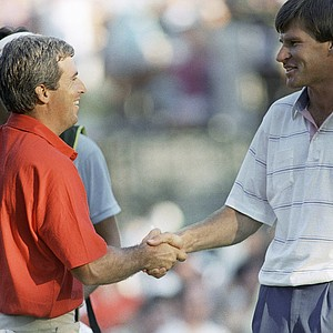 Curtis Strange, left, and Nick Faldo shake hands in Brookline, Sunday, June 19, 1988 after finishing the U.S. open with tie scores forcing a 18 hole Playoff round on Monday at the Country Club in Brookline, Massachusetts.