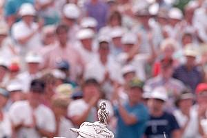 Jeff Sluman kisses his trophy cup after winning the PGA golf championship at Oak Tree Club in Edmond, Okla., Aug. 14, 1988. Sluman shot a six-under-par 65 to defeat Paul Azinger by three strokes.