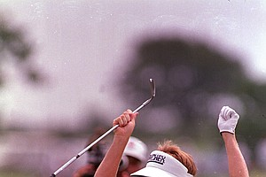 Jeff Sluman of Rochester, N.Y., reacts after chipping in for an eagle at the 5th green during early action in the final round of the PGA golf championship at Oak Tree Club in Edmond, Okla., Sunday, Aug. 14, 1988. Sluman was the leader at 11-under-par heading into the back nine. He went on to win the tourney. (AP Photo/Dave Crenshaw)