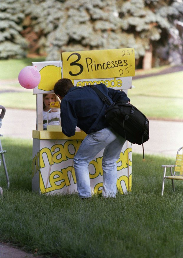Gendolyn Stockman, 5, tells a visitor to the U.S. Open at Rochester, New York on June 14, 1989 that her lemonade costs 25 cents. She had made $26 on Tuesday in afternoon. Her earnings will be used to buy a gift for mother. Her stand is located on the road to Oak Hill Country Club, the site of the U.S. Open.