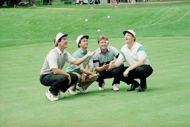 Doug Weaver, Jerry Pate, Nick Price, and Mark Wiebe, left to right, toss golf balls in celebration of their holes-in-one on the 6th hole at the U.S. Open golf tournament in Rochester, N.Y., June 16, 1989.