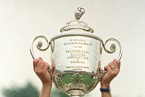 Payne Stewart, of Orlando, Fla., holds up the PGA Championship trophy after his come-from-behind vicotory at Kemper Lakes in this Aug. 13, 1989 photo, in Hawthorn Woods, Ill. Stewart, this year's U.S. Open Champion and winner of 18 tournaments around the world, including three major championships, died in a plane crash, Monday Oct. 25, 1999. He was 42.
