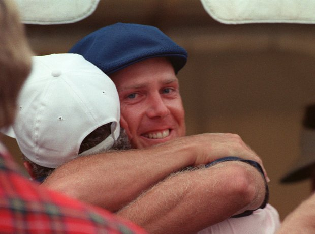 Payne Stewart hugs an unidentified bystander after winning the PGA Championship in Hawthorn Woods, Ill., in this August 13, 1989, file photo. A Learjet carrying golf champion Payne Stewart flew uncontrolled over the nation's heartland for hours Monday Oct. 25, 1999, before crashing in South Dakota, killing everyone aboard.