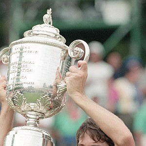 Paul Azinger holds up the Wanamaker Trophy after winning the 75th PGA Championship in a sudden death playoff against Greg Norman at the Inverness Club in Toledo, Ohio, Aug. 15, 1993.