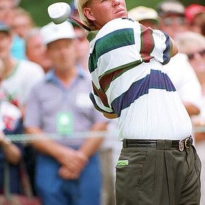 John Daly, the 1991 PGA Champion, tees off with a driver on the fourth hole during the final round of the PGA Championship at the Inverness Club in Toledo, Ohio, Sunday, Aug. 15, 1993. Sunday was the first day Daly used woods in his bag. He used irons only during the other three rounds.