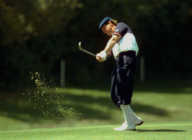 Payne Stewart swings on the seventh hole during the final round of the PGA Championship at the Riviera Country Club in Los Angeles on Sunday, Aug. 13, 1995. Stewart, who is sponsored by NFL Properties, normally wears the colors of the local team at tournaments, but wears a generic NFL outfit for the PGA as Los Angeles has no professional football team.