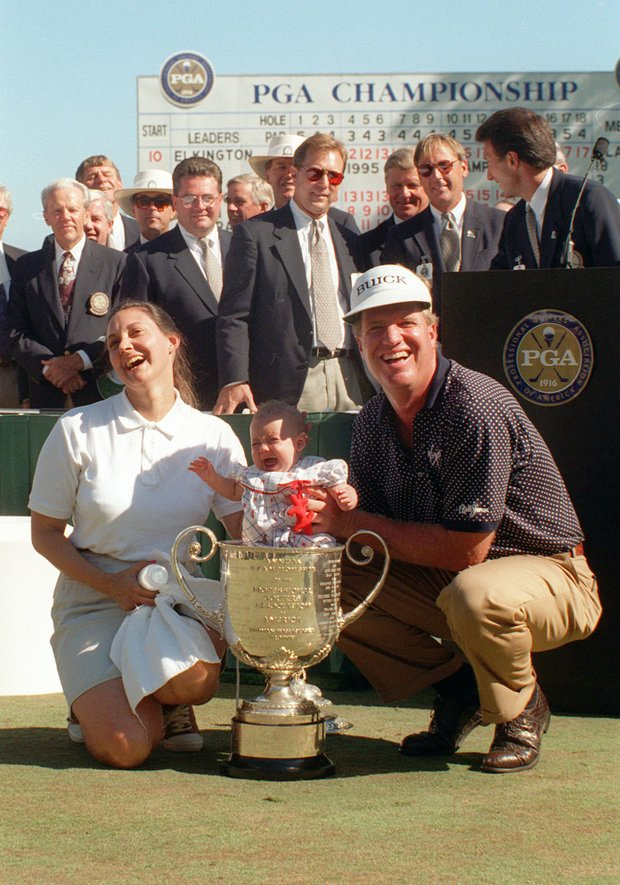 Steve Elkington of Australia and his wife, Lisa, celebrate Steve's win after a sudden-death playoff with Colin Montgomerie at the PGA Championship at the Riviera Country Club in Los Angeles on Sunday, Aug. 13, 1995. Their 4-month-old daughter, Annie, cries after being put inside of the championship trophy.