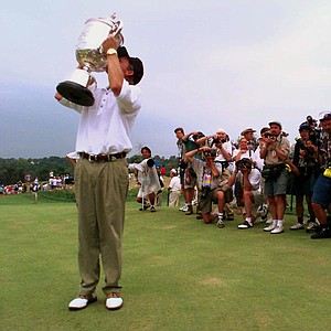 Mark Brooks kisses the Wanamaker trophy as photographers capture the moment after he beat Kenny Perry in a one-hole playoff to win the PGA Championship Sunday, Aug. 11, 1996, at Valhalla Golf Club in Louisville, Ky.