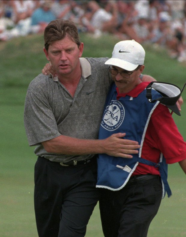 "Nick Price, left, hugs his caddy Jeff ""Squeeky"" Medlen, after finishing up on the 18th green of the PGA Championship at Valhalla Golf Club in Louisville, Ky., Sunday, Aug. 11, 1996. Medlen, who carried for Price in his two PGA Championship and one British Open victories, died Monday June 16, 1997 at his home in Ohio, less than a year after being diagnosed with leukemia. He was 43."