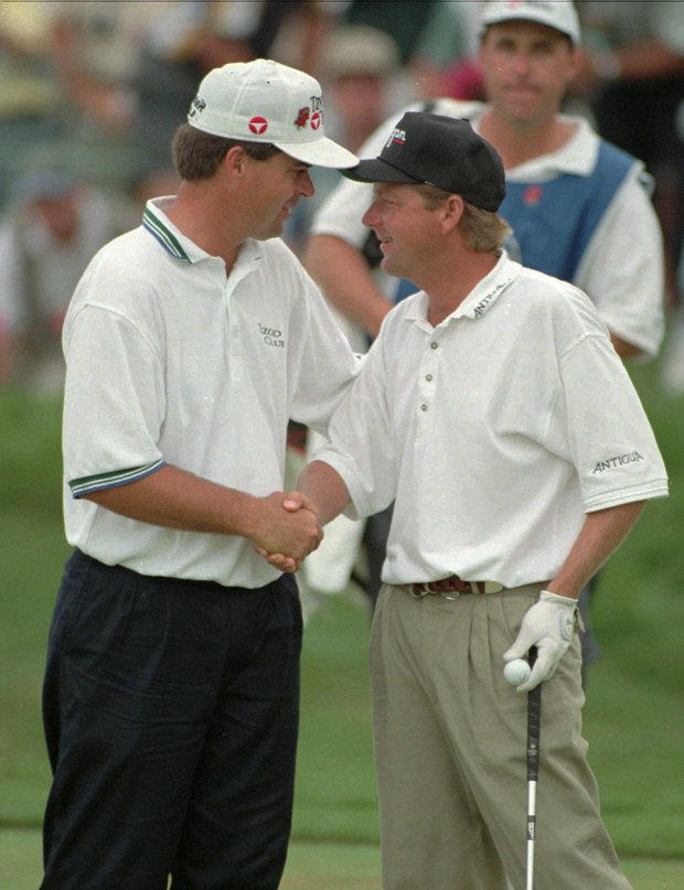 Mark Brooks, right, and Kenny Perry, left, shake hands after Brooks won the PGA Championship after a one-hole playoff at Valhalla Golf Club in Louisville, Ky., Sunday, Aug. 11, 1996.