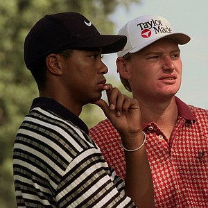 Tiger Woods of Windermere, Fla., left, and Ernie Els of South Africa wait to tee off on the second hole as Justin Leonard hits at Winged Foot Golf Club in Mamaroneck, N.Y., Thursday, August 14, 1997. Woods, Leonard and Els are competing together in the first round of the PGA Championship at the course in the suburbs of New York City. So far this year, Woods has won the Masters, Els the U.S. Open and Leonard the British Open.