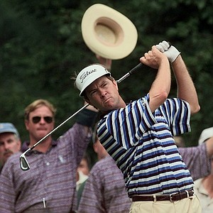 Marshalls signal with their hats as Davis Love III, of Sea Island, Ga., drives from the 17th tee during the first round of the PGA Championship at Winged Foot Golf Club in Mamaroneck, N.Y., Thursday , August 14, 1997. Love finished the round at four under par, tied with John Daly for the lead.