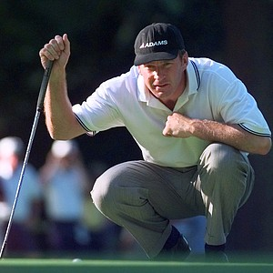 Nick Faldo of England lines up a birdie putt on the third hole during the first round of the PGA Championship at the Sahalee Country Club in Redmond, Wash., on Thursday, Aug. 13, 1998. Faldo missed the putt and settled for par on the hole.