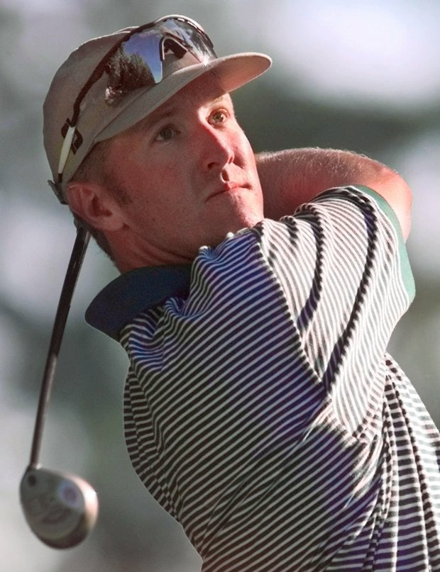 David Duval of Jacksonville Beach, Fla., watches his drive on the second hole during the first round of the PGA Championship at the Sahalee Country Club in Redmond, Wash., on Thursday, Aug. 13, 1998.