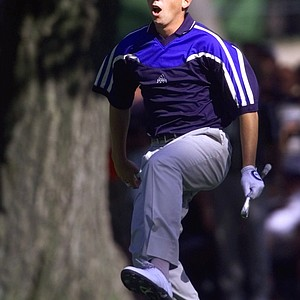 Sergio Garcia, of Spain, leaps in the air to check his ball after he hit it from the base of a tree on the 16th hole during the final round of the PGA Championship at the Medinah Country Club in Medinah, Ill., on Sunday, Aug. 15, 1999. The ball landed on the green and Garcia was able to make par.