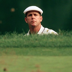 Payne Stewart, of Orlando, Fla., watches his ball on the green after hitting from the bunker on the 13th hole during the first round of the 81st PGA Championship at the Medinah Country Club in Medinah, Ill., on Thursday, Aug. 12, 1999.
