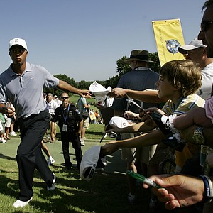 Tiger Woods, winner of the Bridgestone Invitational golf tournament in Akron, Ohio on Sunday, signs autographs for spectators after his practice round for the 89th PGA Golf Championship at the Southern Hills Country Club in Tulsa, Okla., Monday, Aug. 6, 2007.