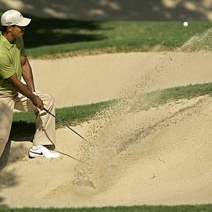 Tiger Woods chips out of a bunker on the 14th hole during the third round of the 89th PGA Golf Championship at the Southern Hills Country Club in Tulsa, Okla., Saturday, Aug. 11, 2007.