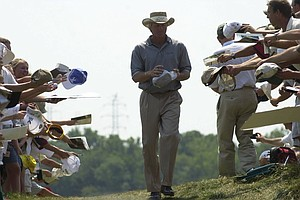 Greg Norman signs autographs Tuesday, Aug. 15, 2000 during practice for the PGA Championship at the Valhalla Golf Club in Louisville, Ky.