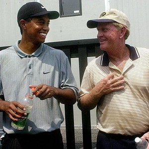 Tiger Woods and Jack Nicklaus share a laugh after completing play in the first round of the PGA Championship, Thursday, Aug. 17, 2000, at the Valhalla Golf Club in Louisville, Ky. Woods finished at 6-under 66 and Nicklaus came in a 5-over 77.