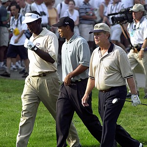 Vijay Singh, Tiger Woods and Jack Nicklaus walk from the first tee during the first round of the PGA Championship, Thursday, Aug. 17, 2000, at the Valhalla Golf Cub in Louisville, Ky. Woods fired a 6-under 66 and Singh and Nicklaus both shot 5-over 77.