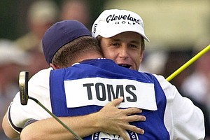David Toms, right, is embraced by his caddie Scott Gneiser after winning the 83rd PGA Championship, Sunday, Aug. 19, 2001 in Duluth, Ga.