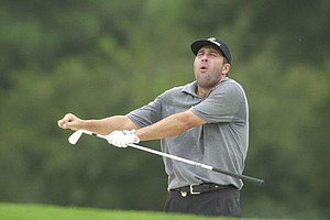 Spain's Jose Maria Olazabal does a dance after hitting his sand shot from the 9th fairway to within a few feet of the pin Monday, Aug. 13, 2001, at the Atlanta Athletic Club in Duluth, Ga. Olazabal was one of the first out on the course before the rain Monday to practice for this week's 83rd PGA Championship.